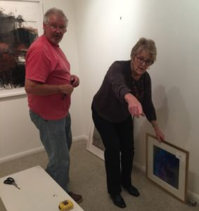 Working on getting the paintings up - Les Love and Leonie Lyall