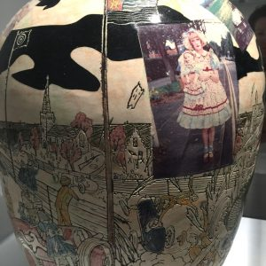 Detail of a vase with photo of Claire Grayson alter ego